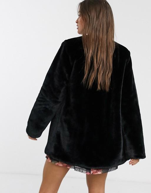 Stradivarius faux fur coat in black | AS