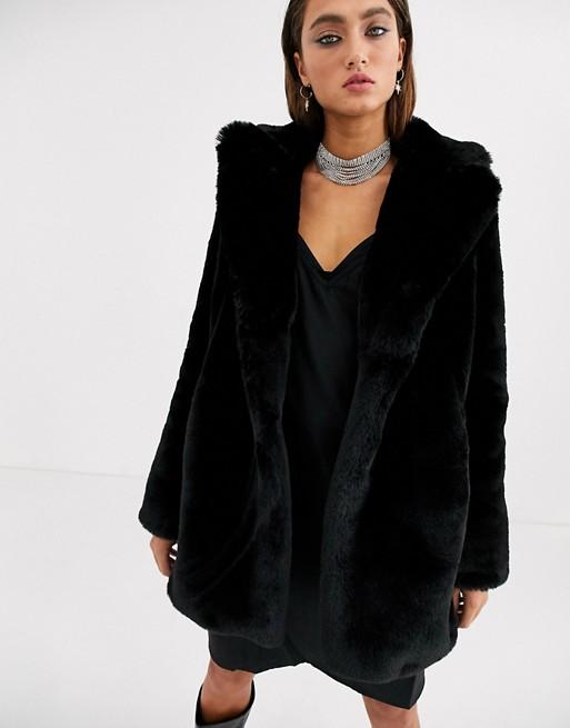 Bershka faux fur longline coat in black | AS