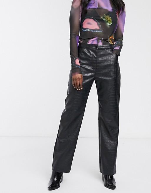 Weekday croc effect faux leather pants in black | AS