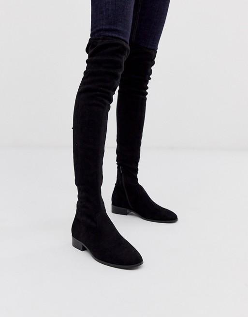 ASOS DESIGN Kayden flat thigh high boots in black | AS