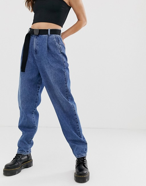 ASOS DESIGN tapered leg boyfriend jeans with curve seam in mid .