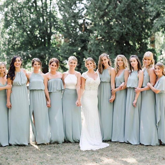 The prettiest line up in Silver Sage bridesmaid dresses .