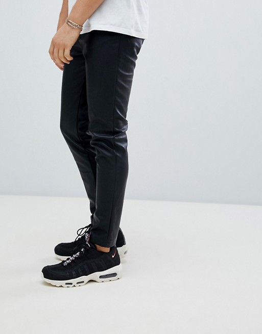 boohooMAN faux leather pants in black | AS