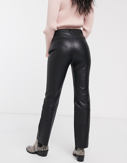 Pull&Bear faux leather pants in black | AS