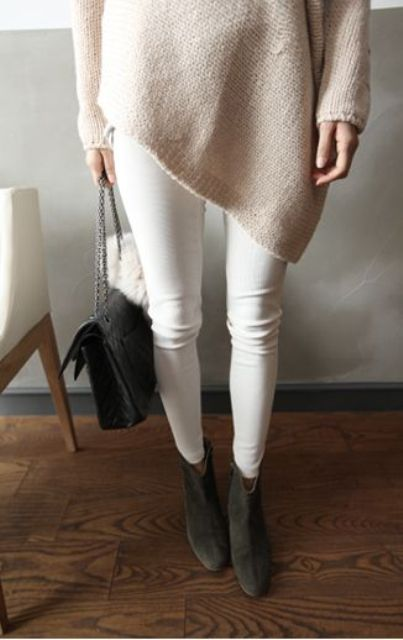Picture Of white jeans, a blush oversized sweater and dark grey .