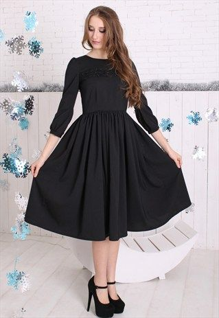 Modest black midi dress with sleeves coming soon to Mode-sty .