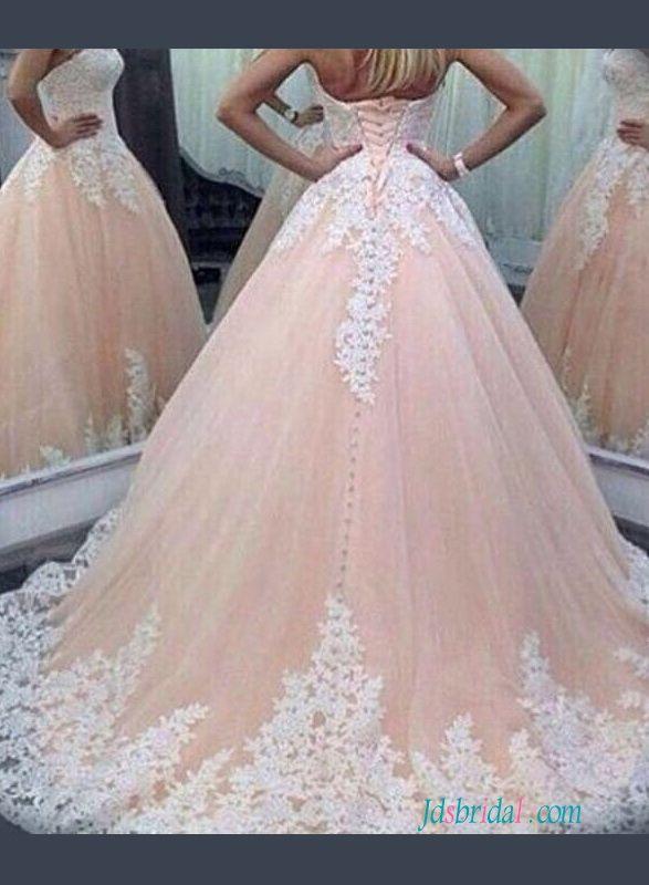 Blush Sweetheart princess pink colored ball gown wedding dress .