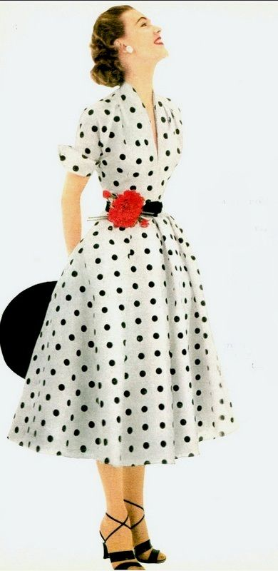 1952 Model in white and black polka-dotted dress of silk shantung .