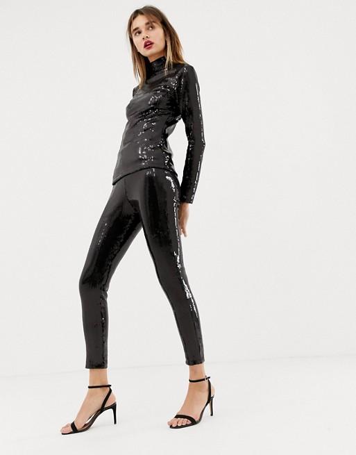 Warehouse x Ashish sequin leggings in black | AS
