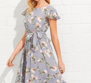 Wear this Light blue floral spring dress to the next spring event .