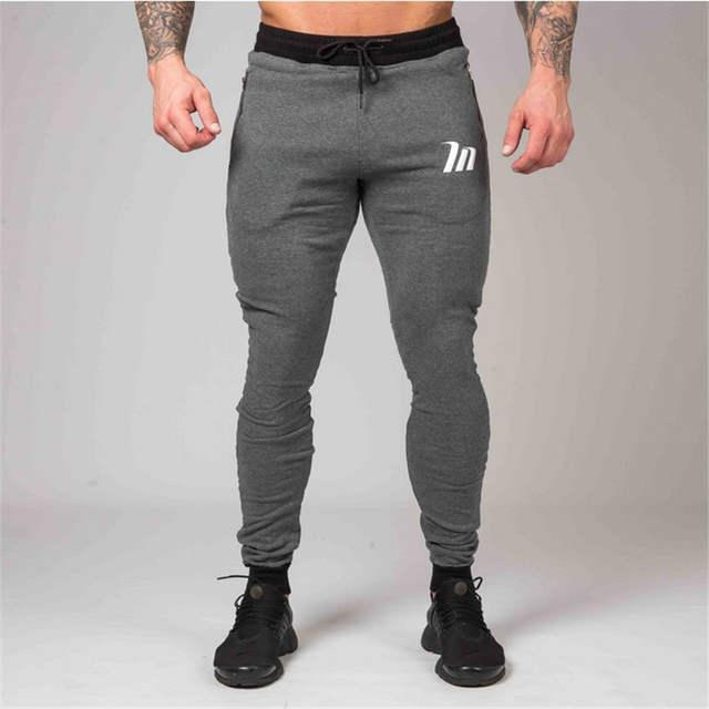 2020 New Tight Men Pants Zipper Packet Bodyboulding Gyms Brand .