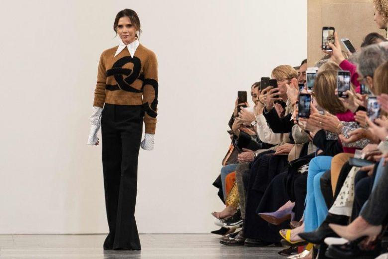 Victoria Beckham goes 'retro' at London Fashion Week show .