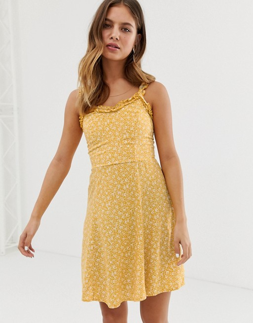 New Look sundress with ruffle edge in yellow ditsy floral print | AS